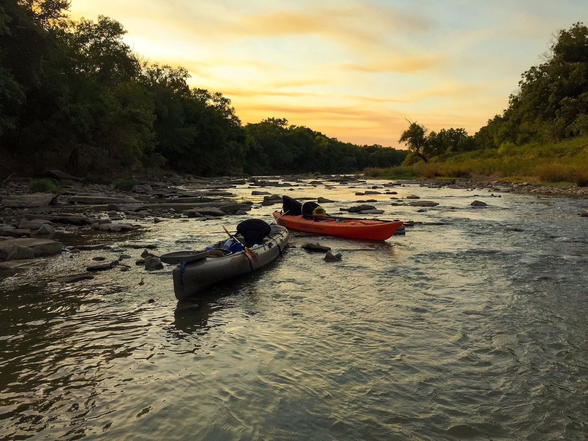 Photo of kayaks on the Colorado River at sunset in San Saba County, Texas